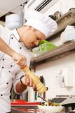 Young chief cook in restaurant Stock Image