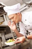Young chief cook in restaurant Stock Photo