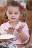 Young child baking Stock Photography