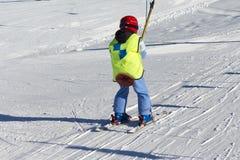 Young Child beginner using the ski lift Stock Photo