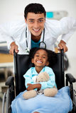 Young child being cared for by a doctor Royalty Free Stock Images