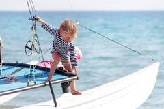 Young child on board of sea yacht Stock Photos