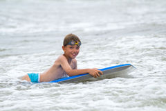 Young child with a bodyboard on the beach Royalty Free Stock Photos