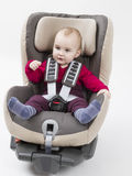 Young child booster seat for a car. Booster seat with child for a car in light background. studio shot Stock Photos