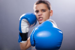 Young child with boxing gloves Stock Images