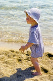 Young child boy enjoys the beach Royalty Free Stock Photo
