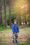Young child boy in the forest holding a lantern in his hand. Young child boy  holding a lantern in his hand in the forest Royalty Free Stock Photography