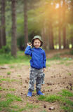 Young child boy in the forest holding a lantern in his hand. Young child boy in forest holding a lantern in his hand Stock Photos