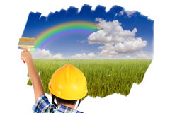 Young child boy painting blue sky stock photography