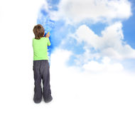 Young Child Boy Painting Blue Sky Over White Stock Image