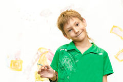 Young child boy painting over white Stock Photography
