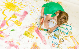 Young child boy painting over white. Cute young child boy painting over white Stock Photo