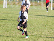 Young child boy playing soccer Stock Image