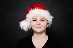 Young Child Boy in Santa Hat Stock Photo