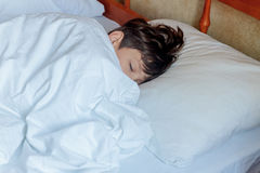 Young child boy sleeping in bed at home, Royalty Free Stock Photography