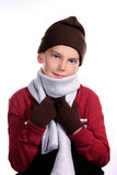 Young Child Bundled Up in Warm Winter Clothing. Young Boy Bundled Up in Warm Winter Clothing on White Background royalty free stock photography