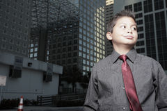 Young child businessman downtown Stock Photo