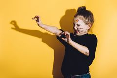 Young child with cat make up streching her hands. Playful child. Body painting Stock Photography
