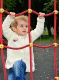 Young child climbing Royalty Free Stock Image