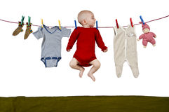 Young child at clothes line Royalty Free Stock Photos