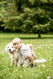 Young child with dog. At garden as friendship concept royalty free stock photography