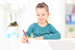 Young child drawing hearts on piece of paper, indoors Stock Photos
