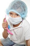 Young child dressed as doctor or researcher Stock Photos
