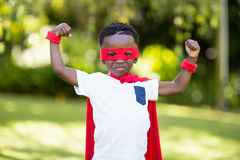 Young child is dressing up as a hero Stock Images