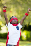 Young child dressing up as a hero Royalty Free Stock Photo