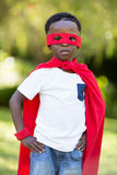 Young child dressing up as a hero Royalty Free Stock Photography