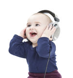 Young child with ear-phones listening to music Royalty Free Stock Images