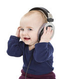 Young child with ear-phones listening to music stock images
