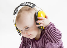 Young child with ear protector Royalty Free Stock Photography