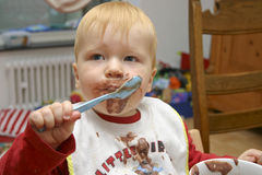 Young child eating Stock Photography