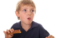 Young child eating french toast. Isolated on white Stock Photos