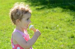 Young child eating ice cream outside Royalty Free Stock Image