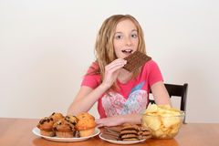 Young child eating large chocolate bar Stock Photo