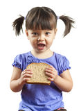 Young child eating sandwich Royalty Free Stock Photos