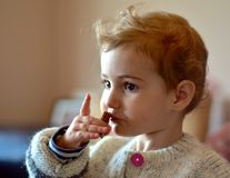 Young child eating a snack indoors Royalty Free Stock Photo