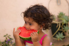 Young child eating watermelon  in summer  Royalty Free Stock Images