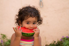 Young child eating watermelon  in summer  Royalty Free Stock Image