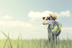 Young child explorer looking at the infinite with his binoculars Royalty Free Stock Photos
