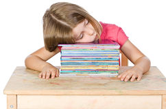 Young Child Falling Asleep on her Books Stock Photography