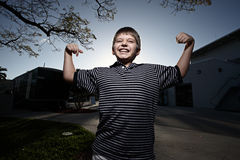 Young child flexing Stock Photography