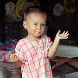 Young child with funny face in Bagan, Myanmar Royalty Free Stock Image