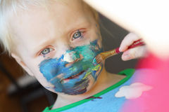 Young Child Getting Face Painted Royalty Free Stock Images