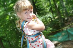 Young child girl in adventure park in safety equipment Stock Photography