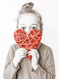 Young child girl holding red heart symbol - love concept Royalty Free Stock Photography