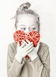 Young child girl holding red heart symbol - love concept Stock Photos