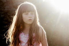 Young child girl on natural background Royalty Free Stock Images